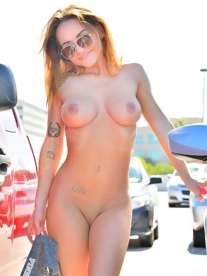 Sports girl Charlotte strips her athletic clothing for a naked public romp