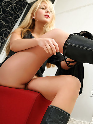 Sexy blonde model Sylvia poses nude in calf high black boots