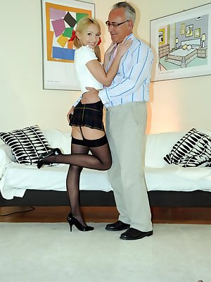Slutty blonde schoolgirl in black stockings with ass plug riding oldman cock
