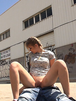 Tattooed European teen Arteya riding cock outdoors in industrial park