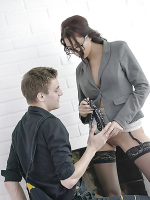Beautiful office worker Paula Shy spreading hose attired legs for oral sex