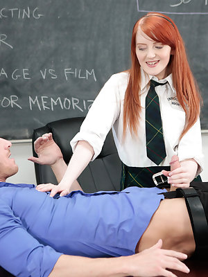 Redhead schoolgirl Krystal Orchid blows her teacher to get out of a detention