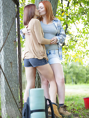 Lesbian girls Eva Berger & Lovenia Lux rendezvous for outdoor pussy fingering