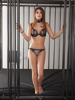 Caged bondage babe Natalia C pinches her nipples & fingers for her master