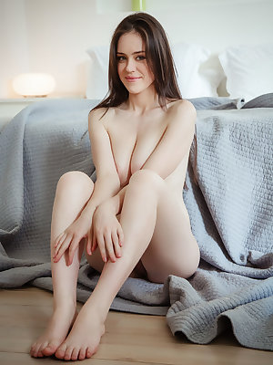 Braless Annis A removes blazer and jeans to relax naked with bare boobs