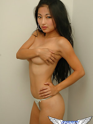 Sexy Asian Aria Lee with small hard nipples posing her naked slender body
