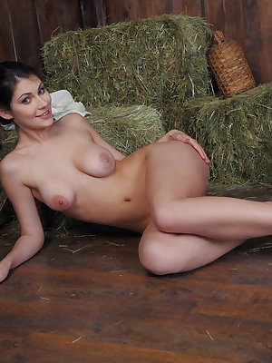 Brunette farm girl Marga A turns herself on with a naked solo roll in the hay