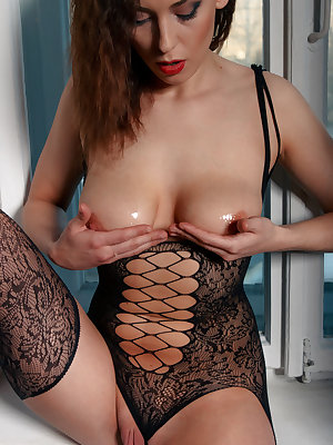 Solo girl Alise Z oils up her bald twat for pussy play in revealing lingerie
