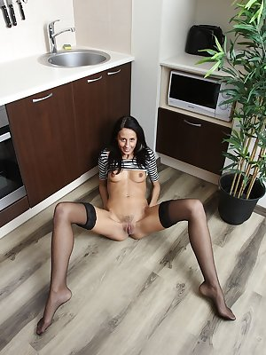 Young amateur girl Elizabete spreads nylon clad legs to show off trimmed muff
