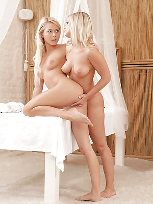 Blonde lesbian teens Grace Hartley and Marry Queen give each other massage