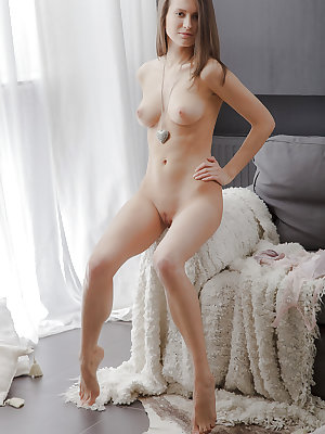 Teen babe Nika is posing naked in close-up scene on camera so hot