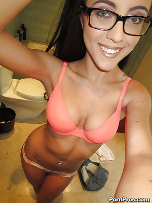 Pretty babe in glasses Roxanne Rae stripping and picturing herself