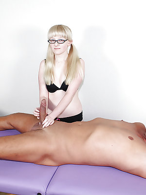 Teenage blondie in lingerie and glasses gives a handjob on a meaty boner