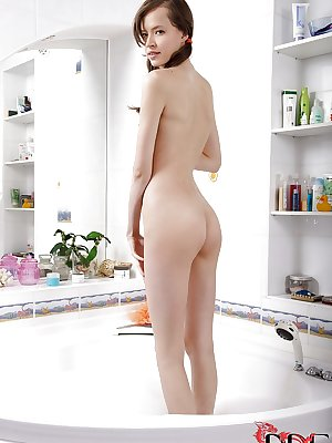 Skinny european girl undressing and playing with herself in the bath