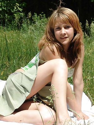 Sweet young teen Liza revealing her firm perky boobs on a blanket in the grass