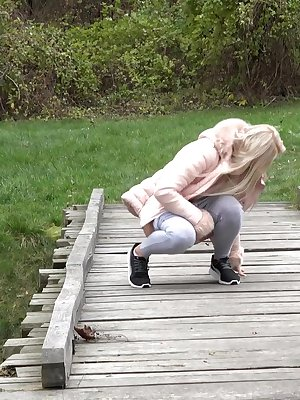 Blonde Katy Sky shows her bald beaver while squatting outside for a pee