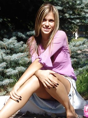 Petite young teen squatting outdoors to flash naked upskirt in the sun