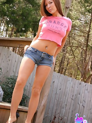 Sexy teen brunette posing outside in tiny booty shorts flaunting her hot ass