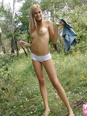 Amateur sweetie takes her skirt and shirt off in the nature and poses