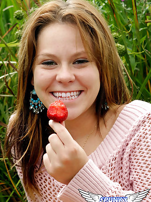 18 year old munches on strawberries after exposing her panties in long grass