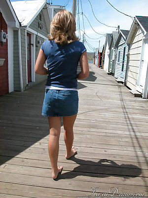 Cute young Karen squats on the pier to flash a hot cotton panty upskirt