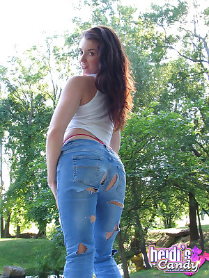 Redhead babe Heidi pulls her tight jeans down and shows attractive booty