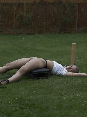 Young blonde girl is tortured in the backyard by her captor