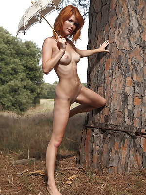 Freckled redhead Mia Sollis goes fr a nature walk completely naked