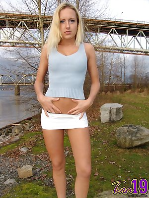Blue eyed Tera flashes nude upskirt & exposes her nice tits by the river