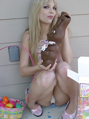 Sweet blonde teen Jana Jordan flashes upskirt panties while eating chocolate