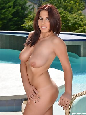 European solo girl Aida Swinger flaunts her big natural tits on poolside chair