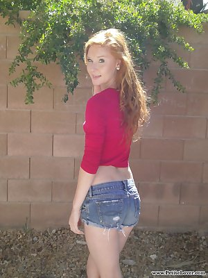 Redhead teen girl Alex Tanner flashes her tiny tits and ass against a wall