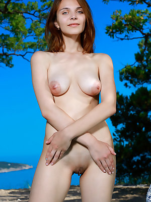 Beautiful Olga Rich removes her short dress to sunbathe nude at the beach