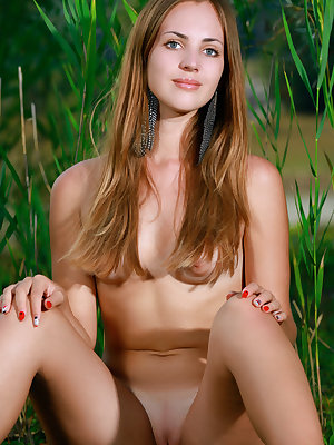 18 year old Hailey shows off her wonderful tanned body and bald muff outdoors