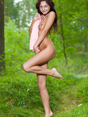 European teenager Dolores M heads into the forest for nude posing